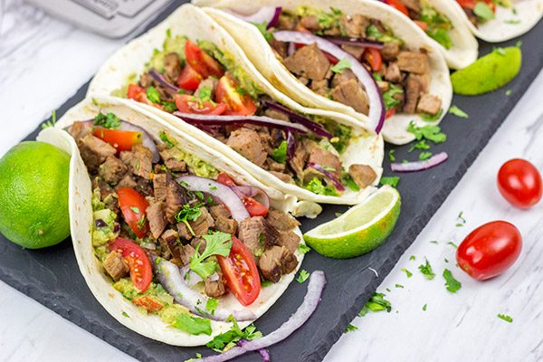 Smoked Brisket Tacos are one of the best things about summer! Learn some brisket-smoking tricks, and grab the recipe for these tasty tacos!