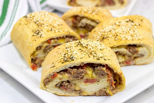 Start with your favorite burger toppings, roll 'em up in pizza dough, and you end up with these tasty (and fun!) Cheeseburger Rollups!