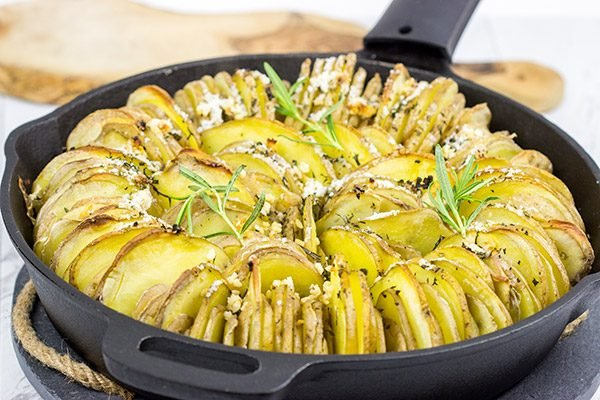 Grab that cast iron skillet!  These Garlic and Rosemary Roasted Potatoes are a fun twist on a classic recipe!