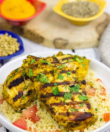 This Grilled Moroccan Chicken starts with an tasty yogurt-based marinade.  Add in the flavor of the grill, and you've got a delicious (and easy) dinner!