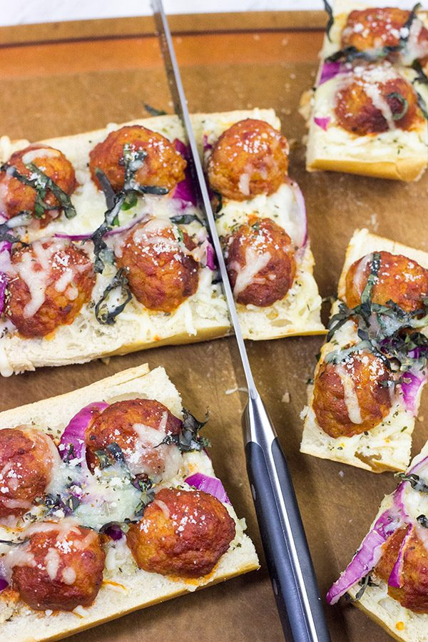 This Meatball Parm French Bread Pizza features garlic butter, melty cheese and meatballs.  Pizza night just got even more delicious!