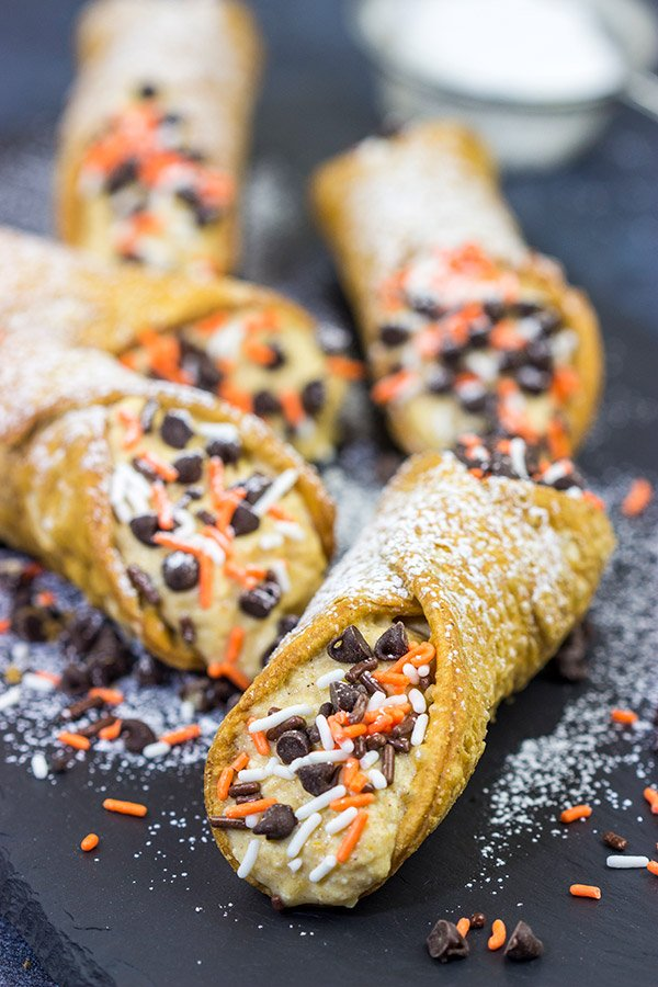 These Pumpkin Spice Cannoli are packed with pumpkin and your favorite Fall spices.  They're a great treat for a cool Autumn evening!