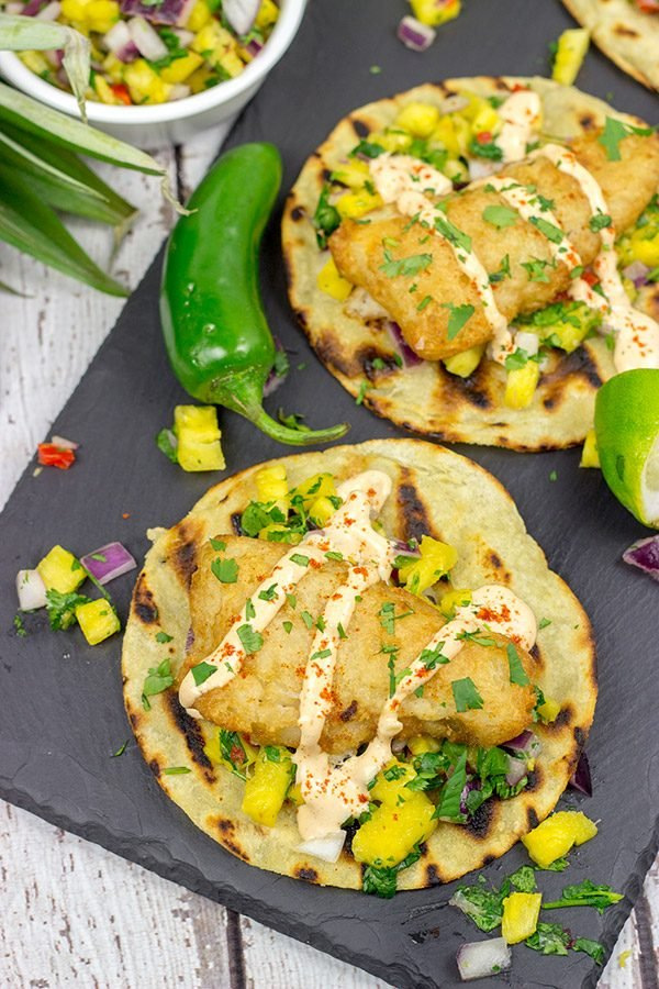 TheseSpicy Fish Tostadas with Pineapple Salsa are a fun combination of sweet and savory flavors...and they're perfect for either weeknight or weekend meals!