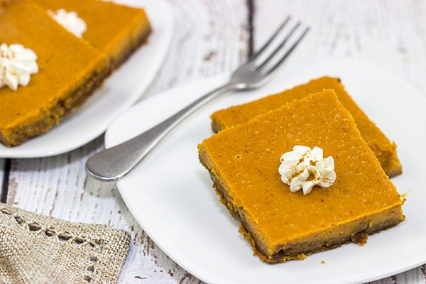 These Pumpkin Pie Bars feature a gingersnap cookie base, and they're the perfect sweet treat for Thanksgiving and holiday parties!
