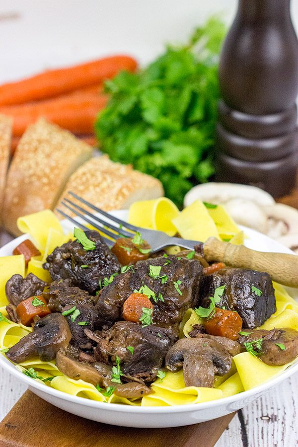 Beef Bourguignon is a classic winter dish that simmers in red wine on low temperature for several hours. It's a delicious meal that's sure to warm you up on these chilly days.
