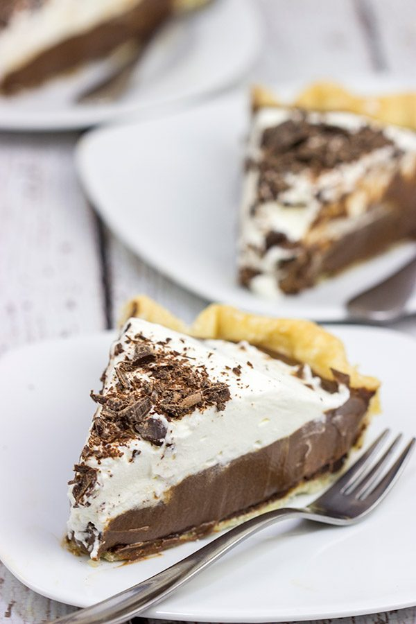 This classic Chocolate Cream Pie recipe features a silky smooth chocolate filling topped with creamy whipped cream.  Sprinkle some shaved chocolate on top, and you've got a delicious dessert to share!