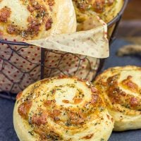 Instead of cinnamon and sugar, these Parmesan Cheese Rolls are stuffed with Italian herbs and cheeses...I dare you to eat just one!