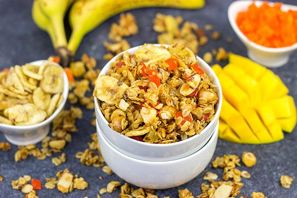 This Tropical Granola is packed with dried fruit, oats and nuts.  Add a spoonful to a bowl of yogurt for breakfast or just it plain as a mid-afternoon snack!