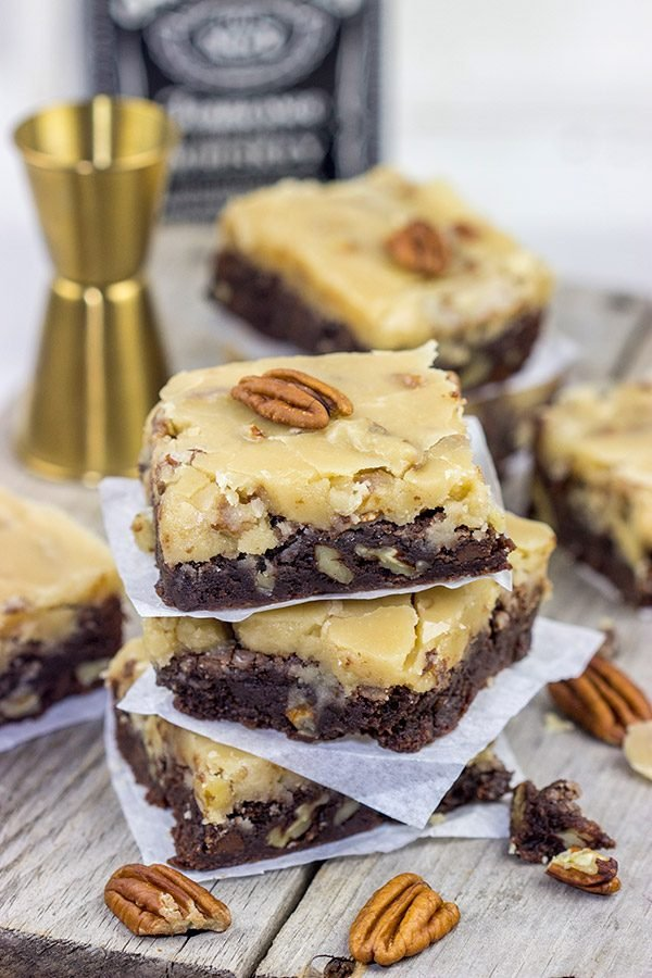 These Bourbon Pecan Brownies are a new favorite in our house! These chewy, chocolatey brownies are topped with a brown sugar + bourbon + pecan frosting...and the result is delicious!