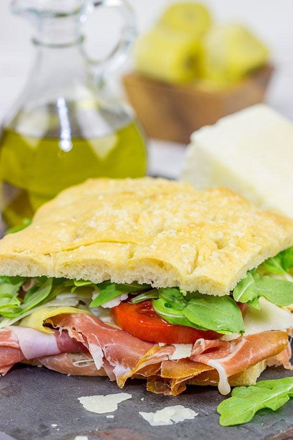 TheseItalian Prosciutto Panini start with a classic Tuscan bread called schiacciata. Add in some Prosciutto di Parma, marinated artichokes and Pecorino Romano, and you've got a delicious sandwich!