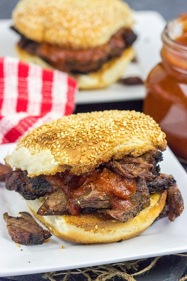 Slow-smoked until tender and juicy, this Smoked Beef Chuck Roast is served with a (surprisingly easy) Maple Bourbon BBQ Sauce!