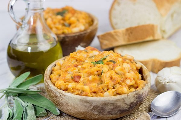 These Tuscan White Beans are a simple, yet delicious Italian recipe featuring white beans, olive oil, San Marzano tomatoes and a bit of fresh sage. Enjoy!