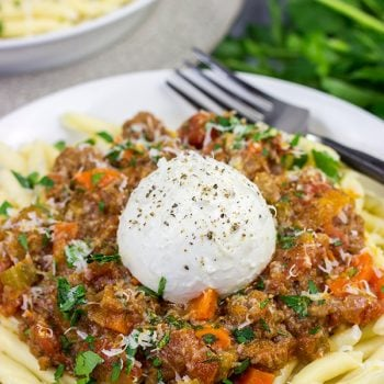 Burrata cheese on top of pasta is simply magical, andthis Burrata Bolognese takes it to a whole new level of deliciousness!