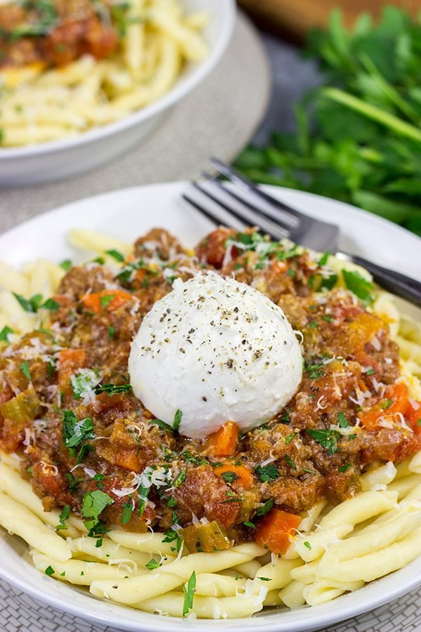 Burrata cheese on top of pasta is simply magical, and this Burrata Bolognese takes it to a whole new level of deliciousness!