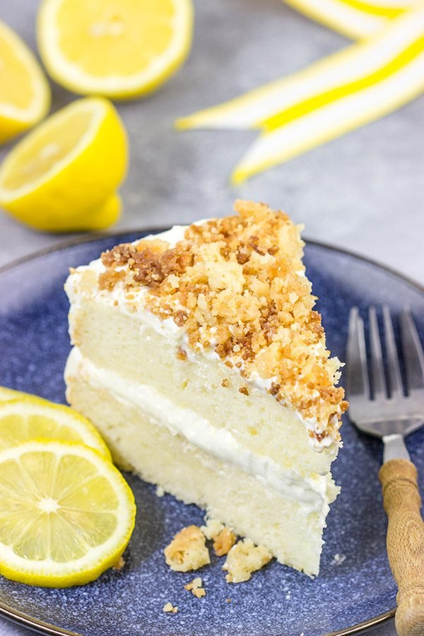 This Lemon Cream Cake features layers of delicious lemon cake topped with a light whipped frosting and crunchy crumbles!