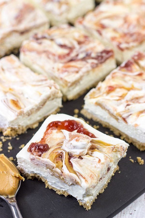 These PB&J Cheesecake Bars are an easy and delicious way to celebrate National Peanut Butter and Jelly Day! (They're also a great dessert for any other day of the year, too!)