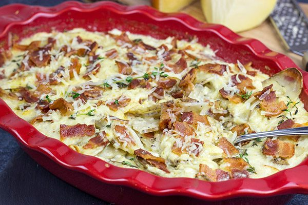 These Cheesy Potatoes au Gratin feature layers upon layers of thinly sliced potatoes covered with two types of deliciousMahón-Menorca cheese!
