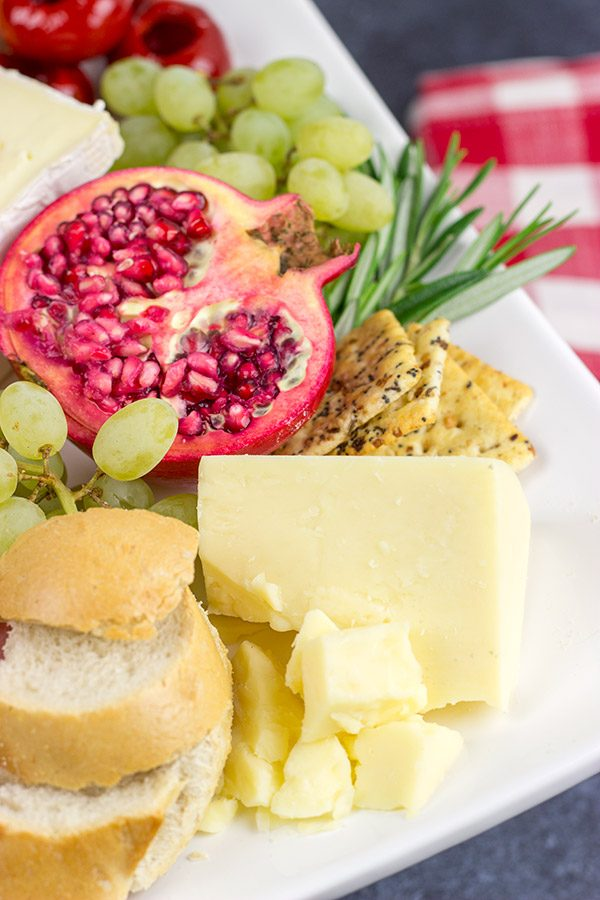 A Holiday Charcuterie Board is a great addition to any holiday party. Here are some and tricks for turning your cheese board into the talk of the party!