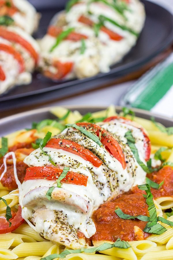 Filled with creamy mozzarella cheese, Roma tomatoes and freshly chopped basil, this Stuffed Chicken Caprese recipe is a new favorite in our house!