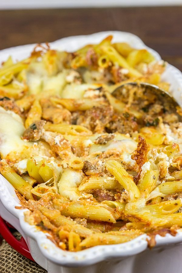 This Baked Ziti with Italian Sausage is an easy, delicious recipe that ranks up there as one of the best comfort food meals of all time. Enjoy!
