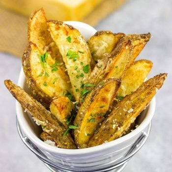 These Garlic Parmesan Baked Potato Wedges are an easy side dish that pairs well with all sorts of other dinner recipes!