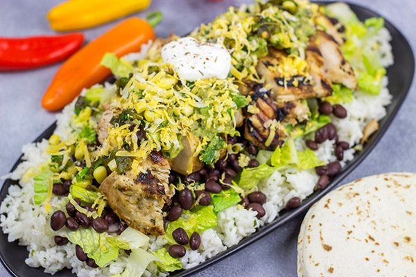 Looking for a delicious and fun recipe to grill this weekend? Put these Grilled Jerk Chicken Burrito Bowls on the menu!
