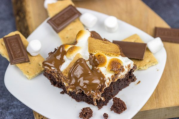 Topped with gooey marshmallows, toasted graham crackers and melted chocolate, these S'mores Brownies are sure to disappear quickly in your house!
