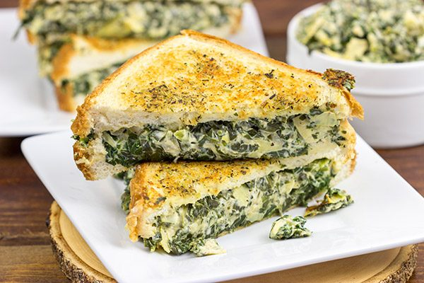 This Spinach Artichoke Grilled Cheese is what happens when you run out of tortilla chips. I think I stumbled onto a favorite new idea for grilled cheese sandwiches!