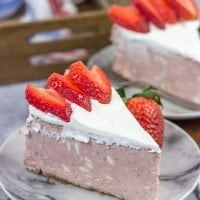 Instead of topping your cheesecake with fresh strawberries, bake 'em straight in! This Fresh Strawberry Cheesecake is a fun dessert for warm summer days!