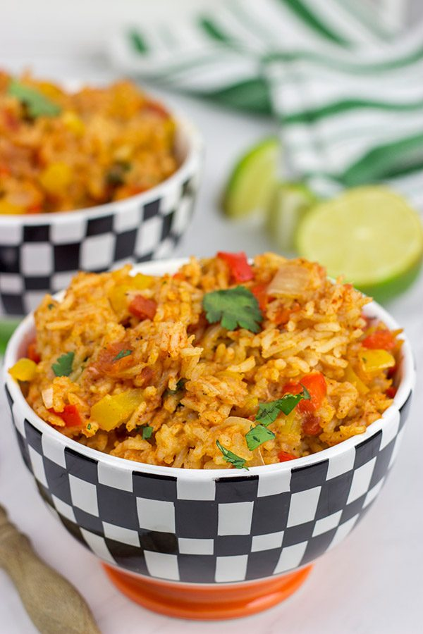 This Slow Cooker Spanish Rice is an easy and delicious side dish that's perfect for both the dog days of summer and the cold nights of winter!