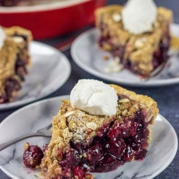Topped with a combination of oats, brown sugar and cinnamon, this Cherry Crumb Pie is a delicious treat on a warm summer evening!