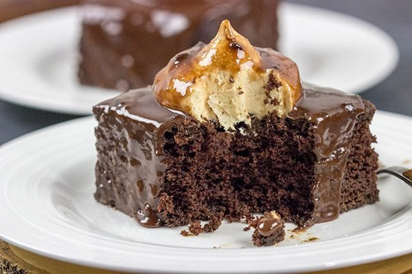 Decadent chocolate cake topped with a scoop of whipped peanut butter frosting...and then coated with chocolate glaze! These Chocolate Peanut Butter Radio Bars are one heck of an awesome dessert!