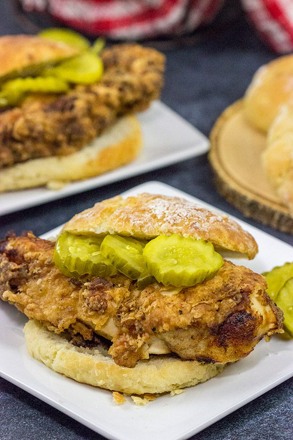 Fried Chicken and Biscuits is a classic recipe for a reason! Homemade buttermilk biscuits topped with juicy fried chicken make for one heck of a comfort food meal!