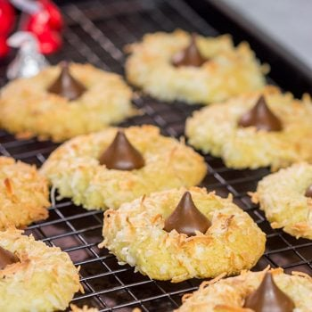 These Coconut Chocolate Kiss Cookies are a fun twist on the classic sugar cookie! Toasted coconut + melty chocolate combine for a tasty sweet treat!