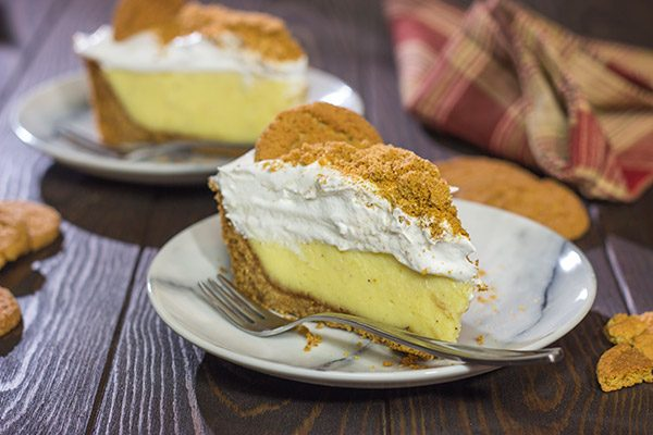 Baked in a gingersnap cookie crust, this Eggnog Cream Pie makes for one heck of a delicious treat during the holidays! Cheers!
