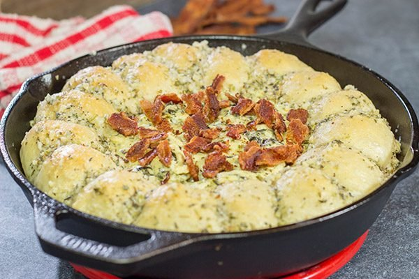 Served right out of the cast iron skillet, this Bacon Spinach Dip with Garlic Knots makes for a fun and tasty Super Bowl appetizer!