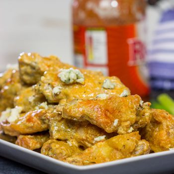 Baked crispy chicken wings.  That's right.  Baked!  These Blue Heat Baked Chicken Wings feature a tasty combination of buffalo sauce and homemade blue cheese dressing.