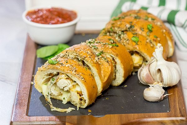 This Chicken Parm Stuffed Garlic Bread is 2 comfort food favorites in 1! Crispy chicken and melty cheese stuffed inside garlicky, buttery bread. Pass me a slice!
