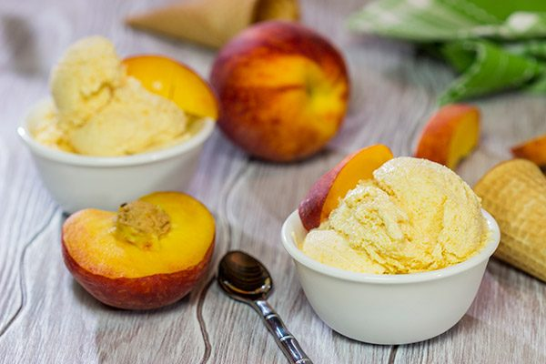 Is it a scorcher outside today? Cool off with ice cream! Celebrate peach season with a batch of this Homemade Peach Ice Cream!