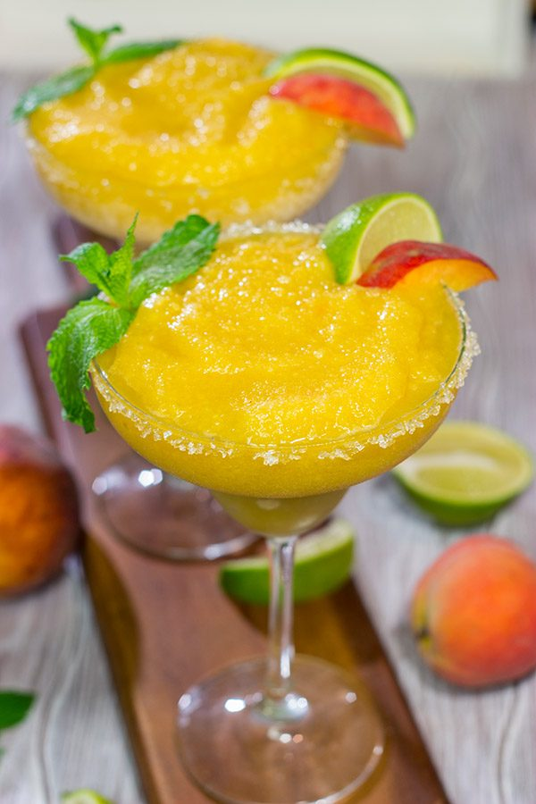 Grab the margarita glasses and celebrate warm summer evenings with a pitcher of these Peach Margaritas! Cheers!