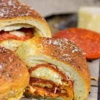 A cross between pizza and a sandwich, this Pepperoni Pizza Bundtwich is packed with flavor! It's the perfect gameday appetizer!