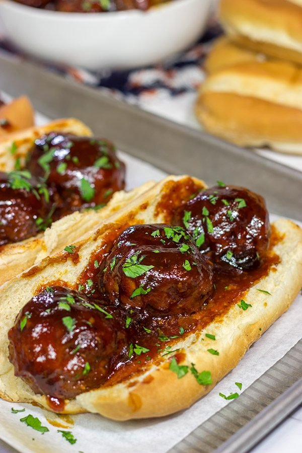 These Slow Cooker BBQ Meatball Subs are an easy and delicious comfort dinner. Perfect for cold winter days!