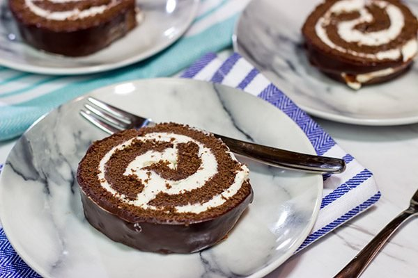 Filled with creamy whipped cream, this homemade Swiss Cake Roll is just like the one ate as a kid...but better!