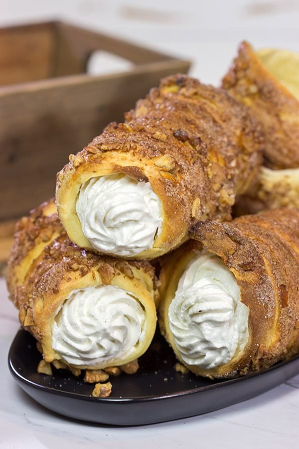 Trdelnik is a unique cinnamon sugar pastry found throughout Prague. Often filled with whipped cream and Nutella, Trdelnik are a delicious sweet treat!