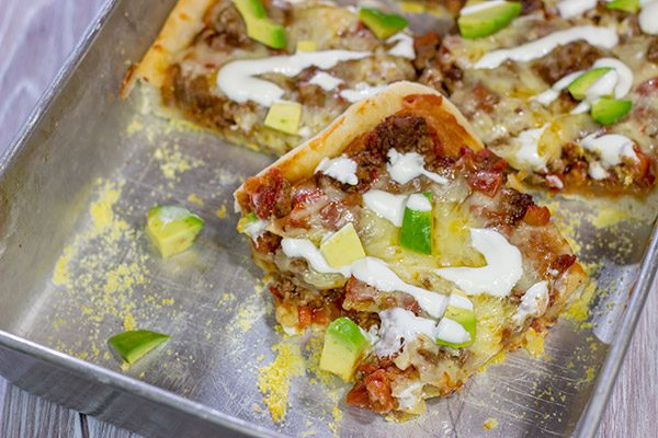 Make tonight a taco...err, pizza...night! This Deep Dish Taco Pizza is a fun way to enjoy your favorite taco toppings in pizza form!