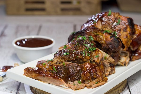 Too cold to pull out the grill? Use the slow cooker instead! These fall-off-the-bone Slow Cooker Baby Back Ribs are a delicious way to enjoy barbecue indoors!