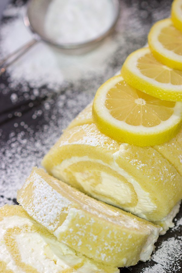 Filled with a whipped cream frosting, this Lemon Cake Roll is a fun dessert for warmer days!