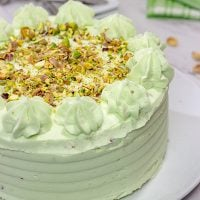 This Lemon Pistachio Cake uses pudding mix in both the cake and frosting for an extra creamy (and extra delicious) cake!