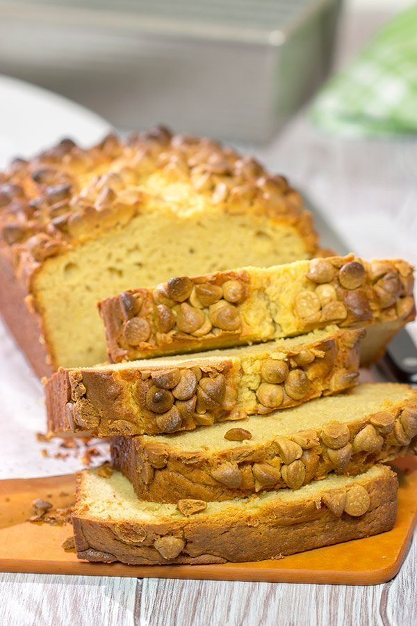 Topped with peanut butter baking chips, this Peanut Butter Bread is a moist cake-like quick bread that's perfect for snacking or dessert!