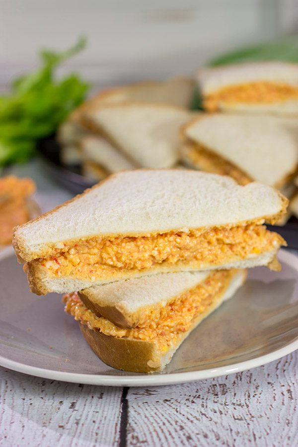 Pimiento Cheese Sandwiches are a classic Southern recipe.  These tasty sandwiches are incredibly easy to make, and they're an excellent choice for a fun party appetizer!